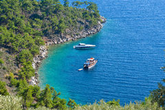 Boats in secluded bay, Thassos Island, Greece Royalty Free Stock Photo