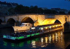Boats on the Seine in Paris. Boats on the night Seine in Paris Royalty Free Stock Images