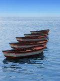 Boats in sequence. Five boats in the calm sea in sequence Royalty Free Stock Images