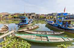 Boats serve tourists at the Thu Bon River, Hoi An, Vietnam Stock Image