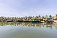 Boats serve tourists at the Thu Bon River, Hoi An, Vietnam Royalty Free Stock Photos