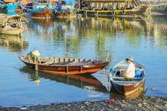 Boats serve tourists at the Thu Bon River, Hoi An, Vietnam Stock Images