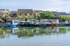 Boats serve tourists at the Thu Bon River, Hoi An, Vietnam Stock Photo