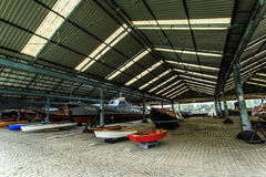 Boats in the ship hangar Stock Images