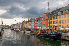 The boats and ships in the calm hurbour of Nyhavn, Copenhagen, Denmark. Nyhavn Stock Photos