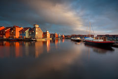 Boats, ships and colorful buildings at Reitdiephaven Royalty Free Stock Photos