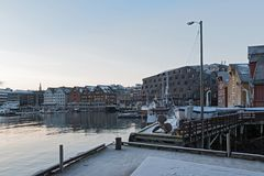 Boats and ships docked in one of tromso city harbor in winter Royalty Free Stock Photography