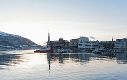 Boats and ships docked in one of tromso city harbor in winter Royalty Free Stock Photo