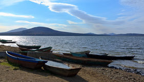 Boats on the shore against the backdrop of the lak Royalty Free Stock Photo