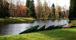 Boats on the shore in the autumn Park Royalty Free Stock Photo