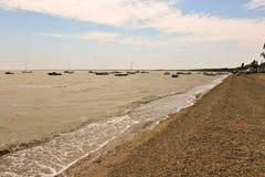 Boats on the shore of the Black sea. Boats near The black sea, waves on the beach, pebble beach, black sea coast, horizon stock photography