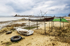 Boats on the shore of the Ladoga Lake in rainy weather Stock Images