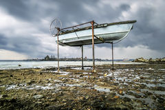Boats on the shore of the Ladoga Lake in rainy weather Royalty Free Stock Image