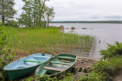 Boats on the shore of a lake. In Vyborg, Russia Stock Photography