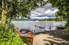 Boats on shore of Lake Windermere Stock Image