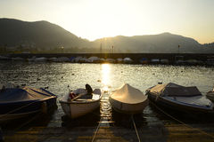 Boats on shore at sunset Royalty Free Stock Photography