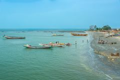 The shoreline of Barra, Gambia. Boats on the shoreline of Barra in Gambia, West Africa Royalty Free Stock Images