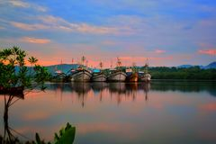 Trawlers parked on the river stock photos