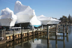 Boats shrin wrapped and stored for winter Royalty Free Stock Photos