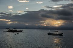 Boats silhouette during cloudy sunrise