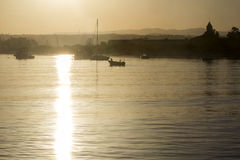 Boats silhouette at sunset, in Quatro Aguas port backgro Stock Photo
