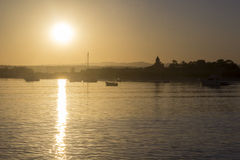 Boats silhouette at sunset, in Quatro Aguas port backgro Stock Photography