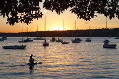 Boats Silhouetted at Sunset Royalty Free Stock Image