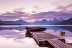 Boats sit on the dock at Lake McDonald Stock Image