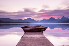 Boats sit on the dock at Lake McDonald Royalty Free Stock Photos