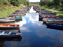 Boats and sky. Rowing boats with sky reflected in water. Taken near Ross Castle in County Kerry, Ireland Stock Photos