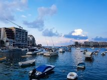 Boats in Sliema in a summer day. SLIEMA, MALTA - AUGUST 05, 2018: a port with many small boats and buildings on a summer day in Sliema, Malta Stock Photography