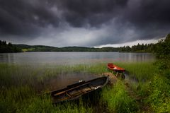 Boats in small bay on Jonsvatnet lake, Norwegian summer time royalty free stock images