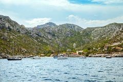 Boats in small beach bay in Massif des Calanques Royalty Free Stock Images