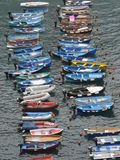 Colourful boats. Small colourful boats lined up in the water at Vernazza, Cinque Terre Royalty Free Stock Photo