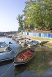 Boats in small fishing port Stock Images
