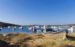 Boats in a small gulf in Ano Koufonisi island, Cyclades, Greece Royalty Free Stock Photos