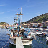 Boats in the small harbor of Giglio Island, the pearl of the Mediterranean Sea, Tuscany - Italy Royalty Free Stock Photo