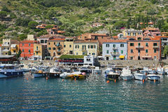 Boats in the small harbor of Giglio Island, the pearl of the Mediterranean Sea, Tuscany - Italy Stock Photos