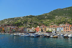 Boats in the small harbor of Giglio Island, the pearl of the Mediterranean Sea, Tuscany - Italy Stock Photography