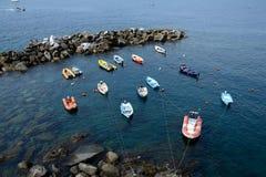 Boats in small harbour in Riomaggiore city Stock Photos