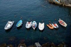 Boats in small harbour in Riomaggiore city Stock Photo
