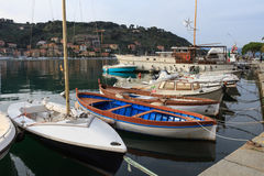 Boats in the small harbour of the village of Le Grazie in Italy Stock Photos