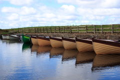 Boats in a small mooring in Donegal - Ireland. A group of boats aligned in a small mooring situated in Donegal - Ireland Stock Photos