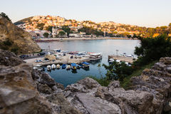 Boats at the small port in adriatic resort in old Ulcinj town during sunset royalty free stock photo