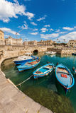 Boats in the small port of Syracuse, Sicily (Italy) Stock Photos