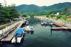 Boats in Small scenic river of Tioman island, Mala. Small river in Tioman island, Malaysia Royalty Free Stock Images