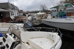 Boats smashed to the ground. BROOKLYN, NY - OCTOBER 29: Boats smashed to the ground in the Sheepsheadbay neighborhood due to flooding from Hurricane Sandy in Royalty Free Stock Photos