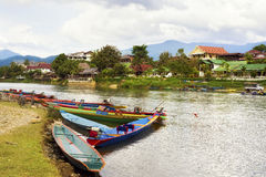Boats by the Song River in Vang Vieng, Laos Stock Image