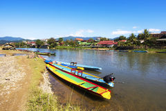 Boats on the Song River in Vang Vieng, Laos Royalty Free Stock Images