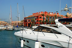 Boats in Sotogrande marina. Yachts and boats in the marina with buildings to the rear, Puerto Sotogrande, Cadiz Province, Andalucia, Spain, Western Europe Stock Photos